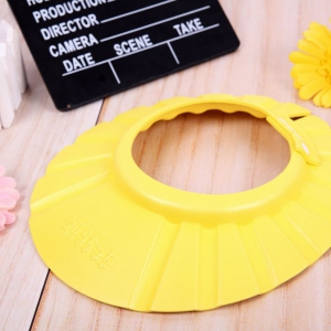 Adjustable Baby shampoo hat yellow colour