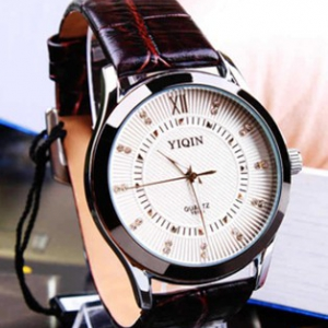 Round face leather strap watch