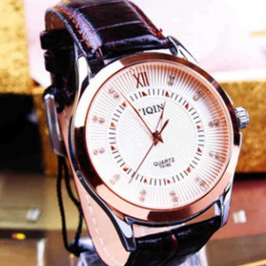 Rose gold face leather watch